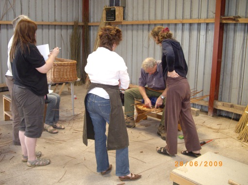 Watching Paul border a willow coffin lid.